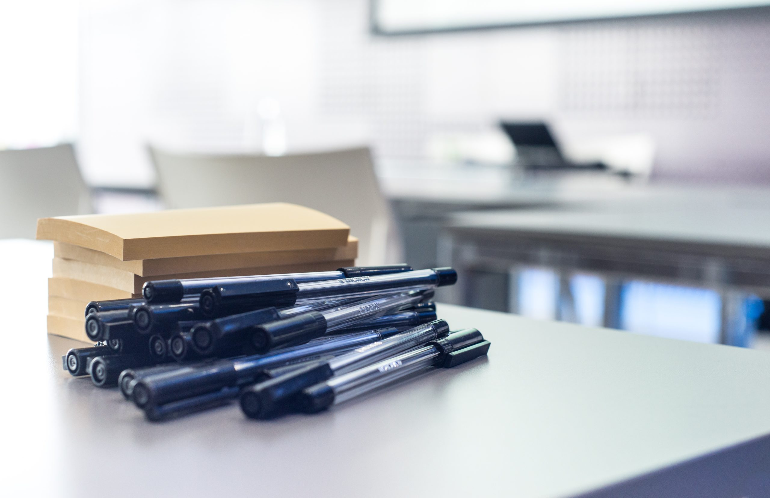 Pens and notepads in an office